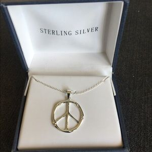 New- Sterling silver  peace sign necklace.